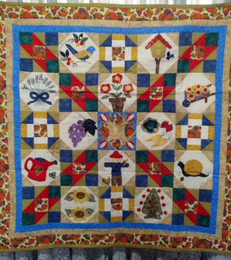 My very first hand sewn applique patchwork quilt  Now hangs on my wall