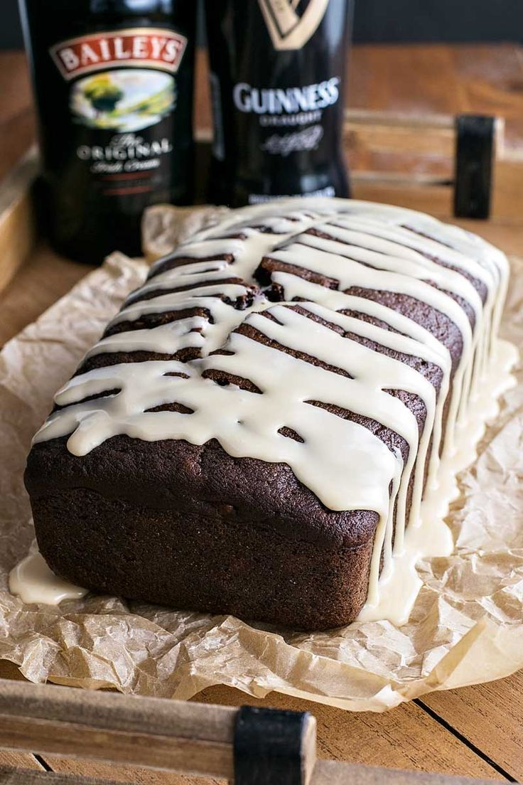 Rich and dark chocolate Guinness bread laced with chocolate chips and walnuts then frosted with a sweet Baileys glaze.