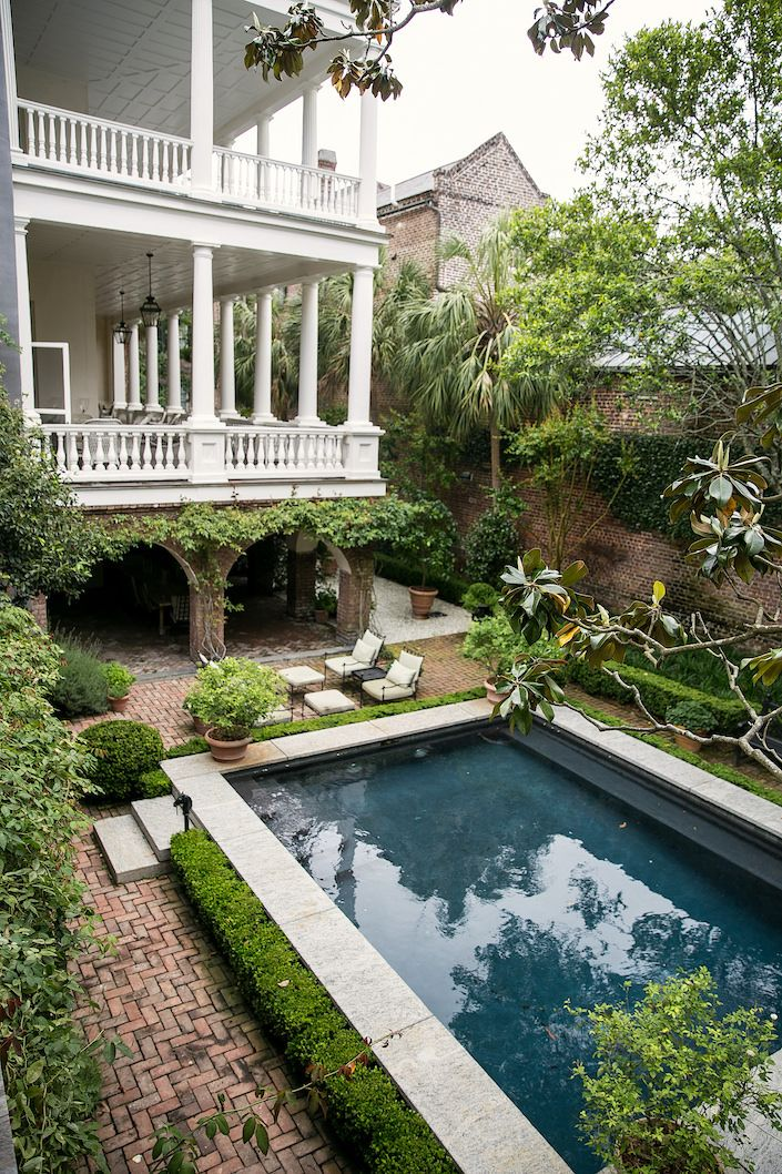 William Gatewood house in Charleston: An enormous, wide four story house with eleven fireplaces, one of the most dramatic features is the multistory piazza along the southern facade, where landscape architect Deborah Nevins installed an allée of Meyer lemon trees in large planters on a path of crushed oyster shells.