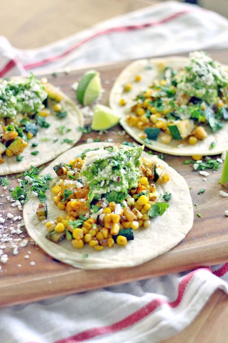 These zucchini and corn tacos with fresh guacamole are simple and healthy, have a bit of a kick, and take only ten minutes to make! ***