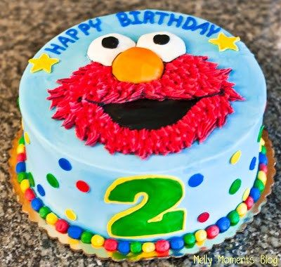 Elmo birthday cake for girls complete with tulle and pink polka