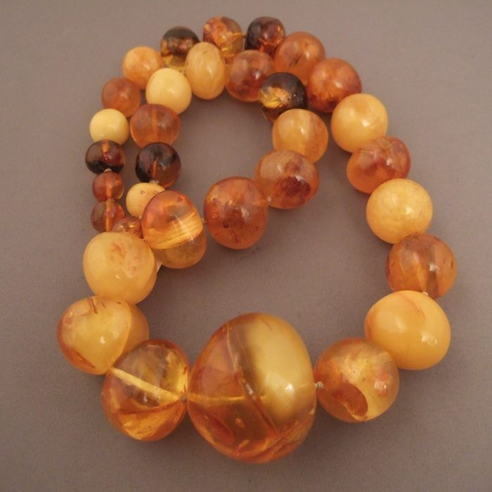 """Amber, baltic area Description : A beautiful amber necklace from Baltic area ... 33 amber beads from the finest quality and classic cut bead and increasing size ... the clasp is a silver carabiner. Gorgeous ! Weight:166gr Length:25,59 inch/65cm Still for sale (price on request) at my gallery at 28, Galerie du Roi at 1000 Brussels and on my website www.halter-ethnic.com under the item """"My Lucky Finds"""""""