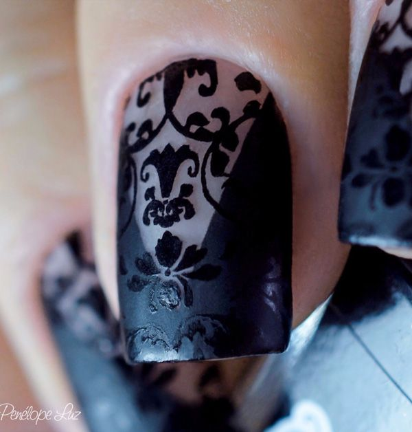Black polish lace nail art design. Draw on intricate lace designs on your nails over a v-shaped polish against your clear coat.