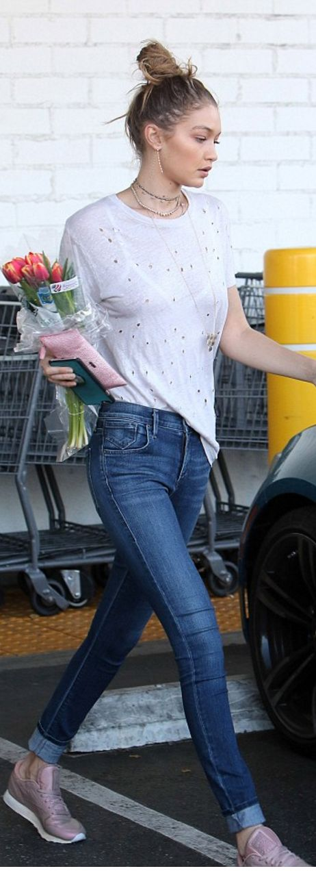 Who made Gigi Hadid's white tee, blue skinny jeans, and pink sneakers?