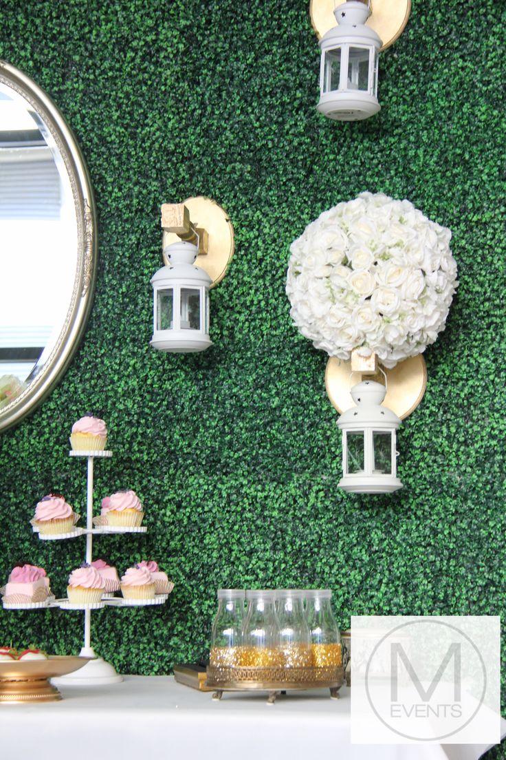 Topiary backdrop, white rose ball,white lanterns ,Vintage mirror, glitter bottles all part.Great display for weddings,kitchen teas,vintage inspired drink station or dessert bar.