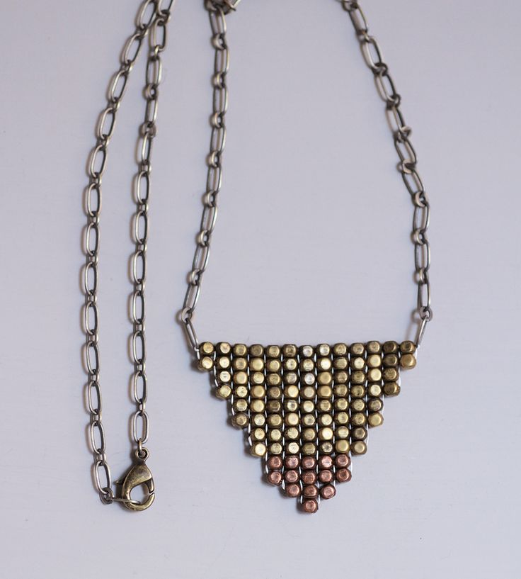 Metallic Woven Bead Necklace by Whisperwill on Scoutmob Shoppe. A beautiful beaded triangle necklace handcrafted using a traditional Native American weaving technique.