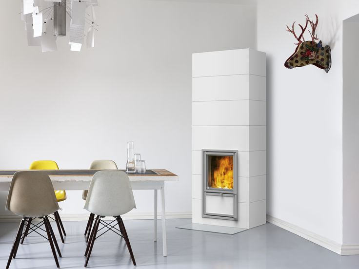 Nuuta heat-retaining corner fireplace with vertical full-bodied tiles in white. www.tulikivi.fi