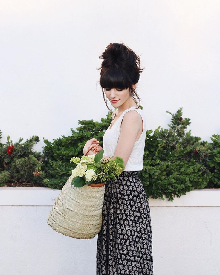 @newdarlings instagram - top knot bun - vintage skirt - basket with flowers