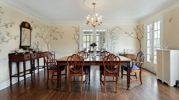The dining room is much lighter and brighter in the real house, but still very traditional, with walls hand-painted by artist Sydney Barton: