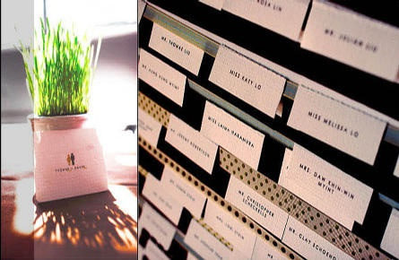 Escort cards mounted on satin ribbon