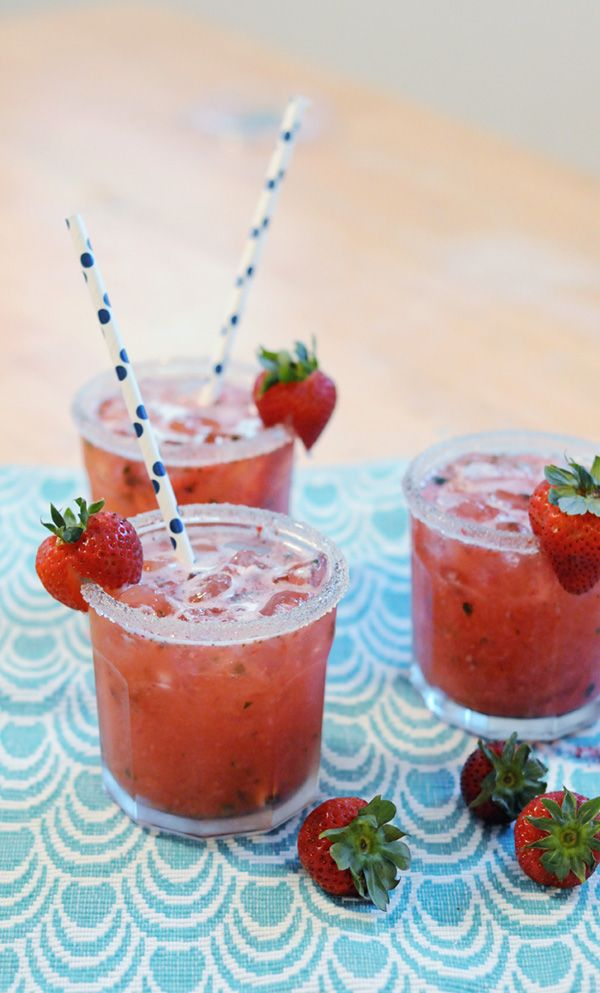 This Strawberry + Basil Ginger Cocktail is made with fresh strawberries and basil, giving it a fruity flavor with a touch of herbs. Top it with ginger ale for a little zing!