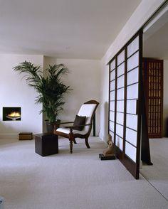 White Asian - Modern Living Room A modern white sitting room, neutral carpet, simple fireplace, Japanese style sliding door.