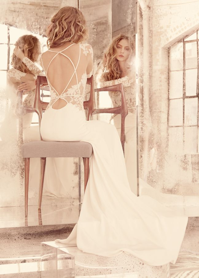 Mona -- Ivory long sleeve lace A-line bridal gown, illusion bateau neckline with V-front and keyhole back, piping detail and sheer lace accent at hip, complete with slim silk crepe skirt // Hayley Paige Bridal Gowns Fall 2015 Collection