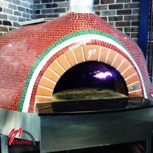 The GR140 Valoriani wood fired oven at The Italian in Willoughby, NSW was originally finished with a simple ivory painted render, but has since been updated with a traditional Italian themed tile.