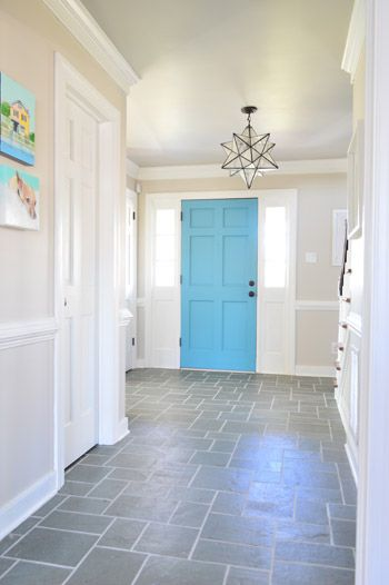 Love everything about this entry.... the tile, door & light fixture. (Walls need colour)
