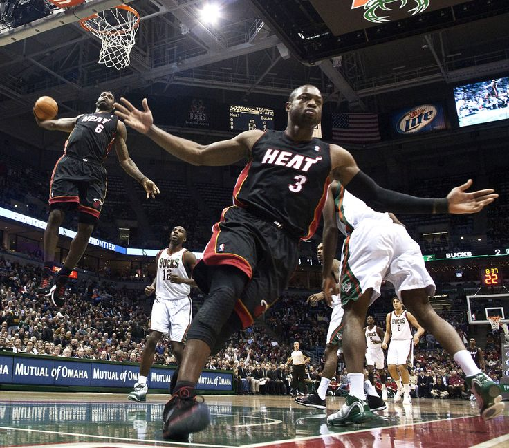 Lebron James (#6) Dunks and Dwayne Wade (#3) playing in the NBA for the Miami Heat. Not a Heat fan, but these players are some of the most talented in the game.