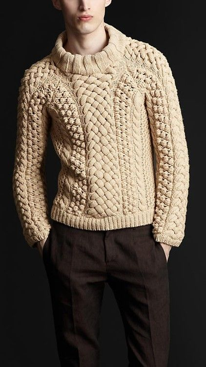 Cable sweater on off-white