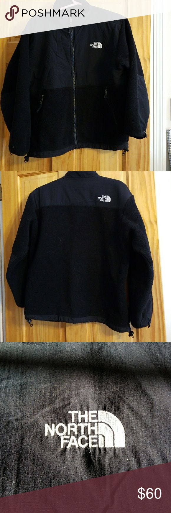 A North Face fleece jacket. This is a black on black fleece North Face sweater/jacket in very good condition. Its very warm and comfy. North Face Jackets & Coats