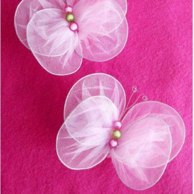 Tulle Butterflies Tutorial A fun project, party decoration or in your kid's room! Make them and hang them on fishing line or string so they look like they are flying through the room!