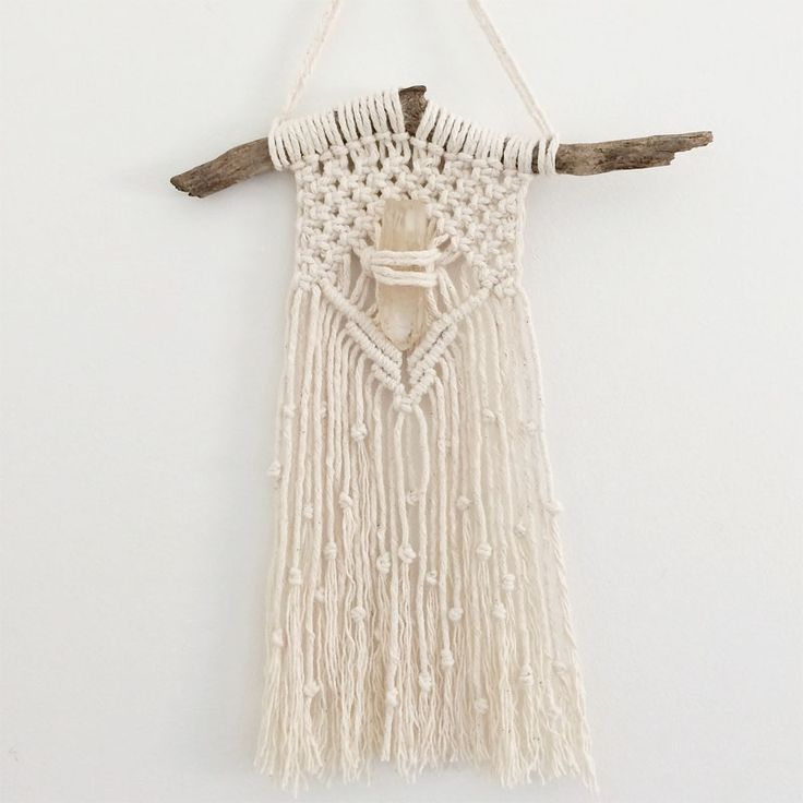 Macrame wall hanging with a Lemon Quartz crystal. Buy now: www.heartandhandscreations.com