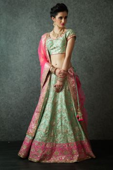 Pure raw silk lehenga and blouse with net dupatta embellished with zari and gota work from #Benzer #Benzerworld #lehenga #ghagracholi #womenswear #WeddingDressForWomen #BridalWear