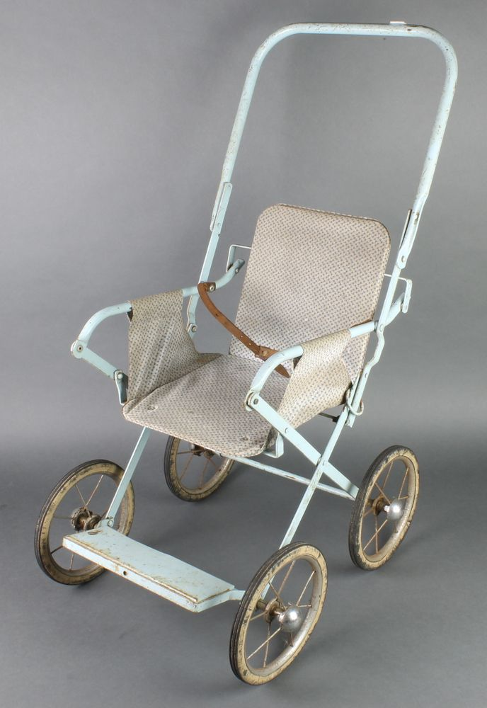 Lot 253, A child's metal push chair, est £30-50