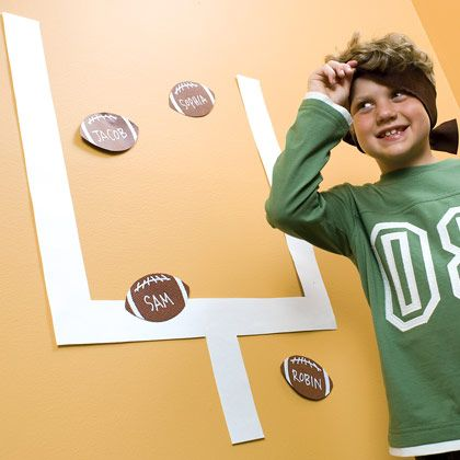 Watching football with the kids? Keep the action going during commercials with this wall football game.