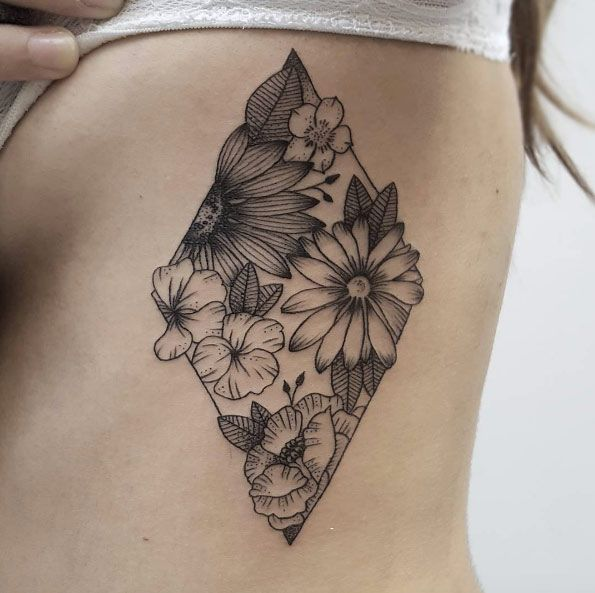 Floral-filled diamond tattoo on rib cage by Isabel Barcelona