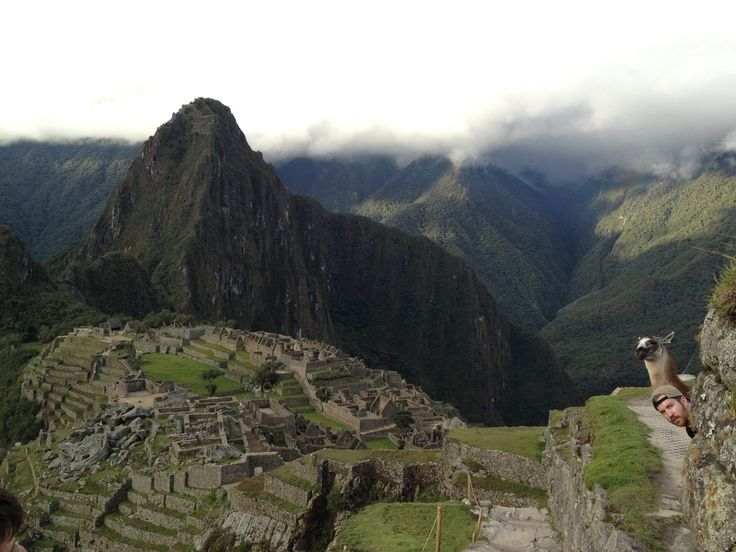"""21 Photographers Share The Most Amazing Shot They Ever Captured """"Unedited picture a friend took of me and a new friend at Machu Picchu, who was happy to pose - taken on an iPhone 4. Photo credit to Hussein Nasreddin."""""""
