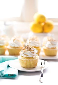 must try recipe; amazing, super rich yet soft, fluffy lemon sour cream cupcakes (made with cake flour, extra egg yolks, and a lot of butter) filled with a tart, rich homemade, best lemon curd (made with plenty of butter) and topped with a sweet meringue frosting