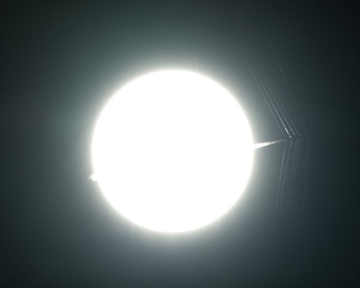 An Air Force Test Pilot School T-38C passes in front of the sun at a supersonic speed, creating shockwaves that are caught photographically for research. NASA is using a modern version of schlieren imagery to visualize supersonic flow phenomena with full-scale aircraft in flight. The results will help engineers design a quiet supersonic transport.