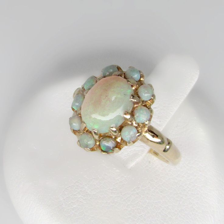 gold  opal ring, Australian opal ring, opal cocktail ring, October birthstone ring, opal cluster ring, vintage opal ring, opal clusster ring by simonefinivintage on Etsy https://www.etsy.com/listing/400178261/gold-opal-ring-australian-opal-ring-opal