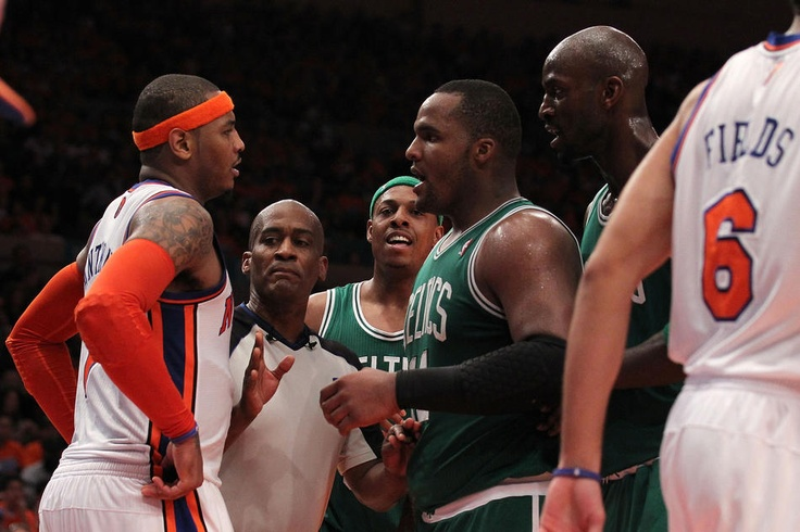 Referee Derrick Collins #11 seperates Carmelo Anthony #7 of the New York Knicks and Glen Davis (2nd R) #11, Paul Pierce #34 (C) and Kevin Garnett (R) #5 of the Boston Celtics. NBA Playoffs 2011
