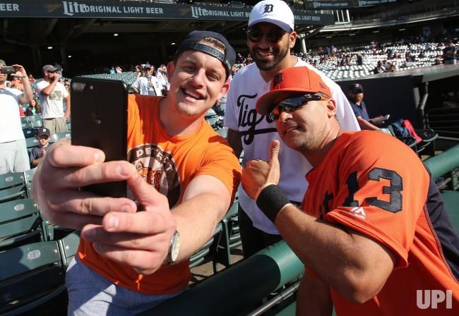 Detroit Tigers fans take a selfie with Omar Vizquel prior to the Tigers game against the Cleveland Indians at Progressive Field in…