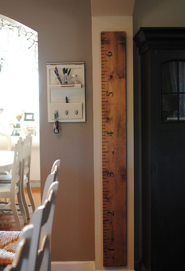 Ruler Growth Chart - neat idea. You can mark on the ruler rather than a doorframe. Then if you ever moved, you could take it off the wall and bring it with you. :) Cute!