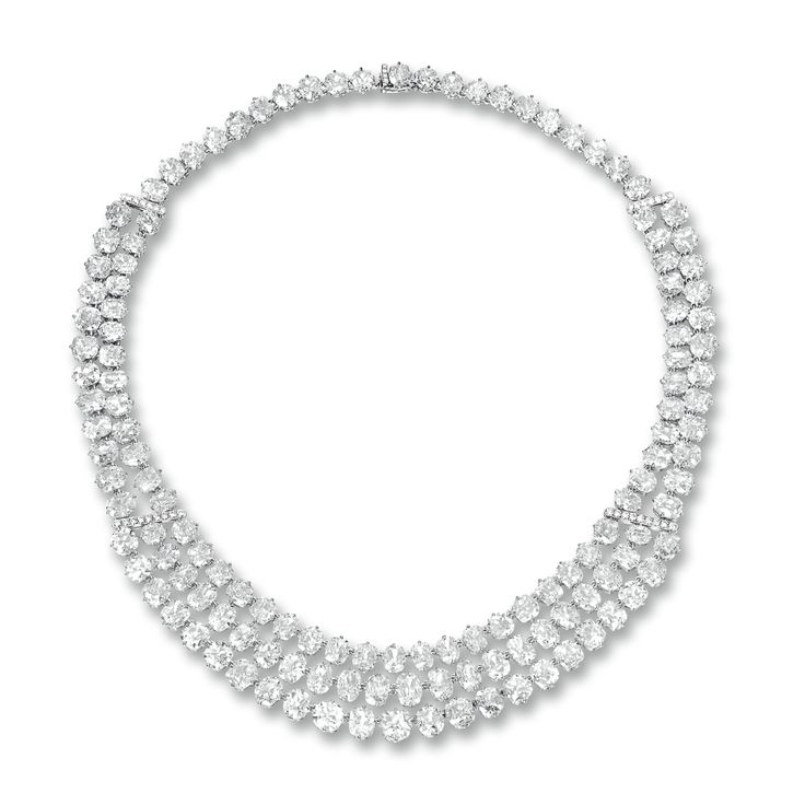 DIAMOND NECKLACE The front compose of three tier of cushion-shaped and old mine-cut diamonds, extending to a two row and single row of similarly-cut diamonds, the diamonds together weighing approximately 95.35 carats, mounted in 18 karat white gold, length approximately 430mm.