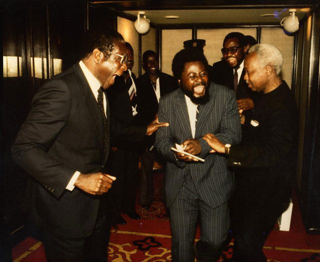 Wilf Mbanga flanked by Robert Mugabe and Julius Nyerere (then president of Tanzania) in india in 1983.