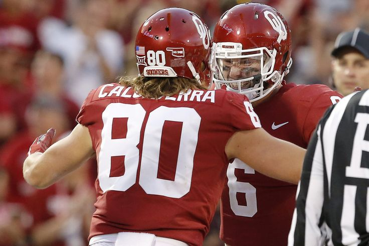 Oklahoma's Baker Mayfield (6) celebrates with Oklahoma's Grant Calcaterra (80) after throwing a touchdown during a college football game between the Oklahoma Sooners (OU) and the West Virginia Mountaineers at Gaylord Family-Oklahoma Memorial Stadium in Norman, Okla., Saturday, Nov. 25, 2017. Oklahoma won 59-31. Photo by Bryan Terry, The Oklahoman