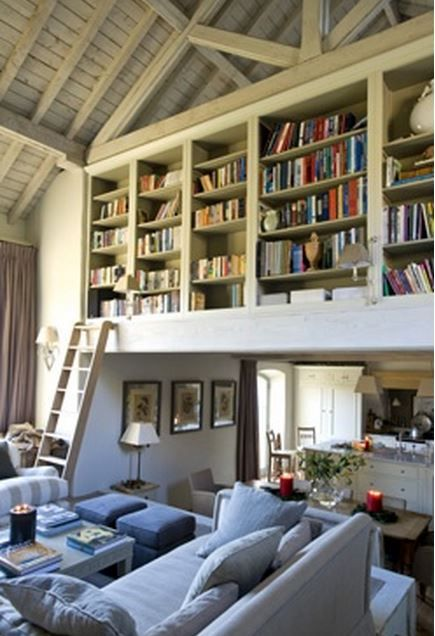 By far, the most brilliant use of 'dead' space I've ever seen!  Sims Hilditch barn conversion bookshelves. And the ceiling treatment is wonderful as well. Bravo!
