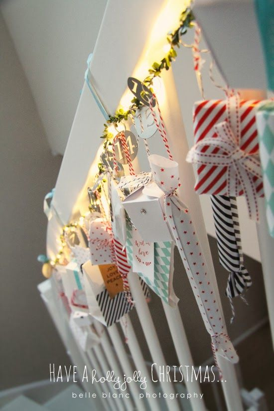 Love this Christmas advent calendar look—great idea for the stair railing—the various gifts & gift wrap work really well together with the lights & the metal numbers❣