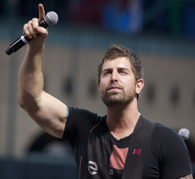 "Jeremy Camp. ""We will overcome / By the blood of the Lamb and the word of our testimony / Everyone, overcome."""