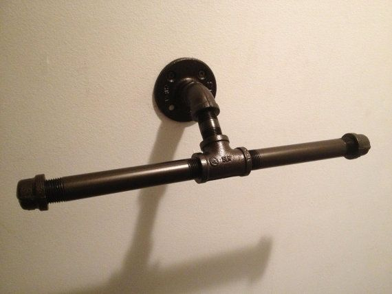 Love this for a spare toilet paper roll. I have most of these fittings in the garage!