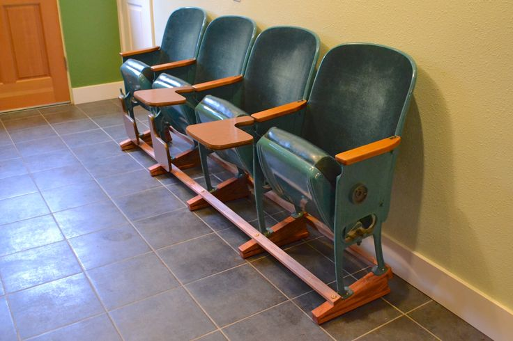 Kitchen seating: old university auditorium seats on a custom wooden base