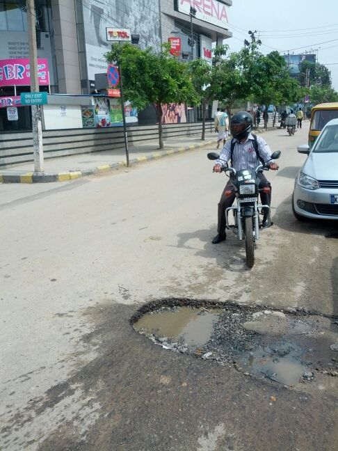 """#Bangalore #Doddanekkundi """"Huge potholes on service road outside total mall, doddanekkundi"""" Aditya Desai. Click on the link to VOTE UP Aditya's complaint to get the issue resolved faster: http://bit.ly/1tDZ6Fi"""