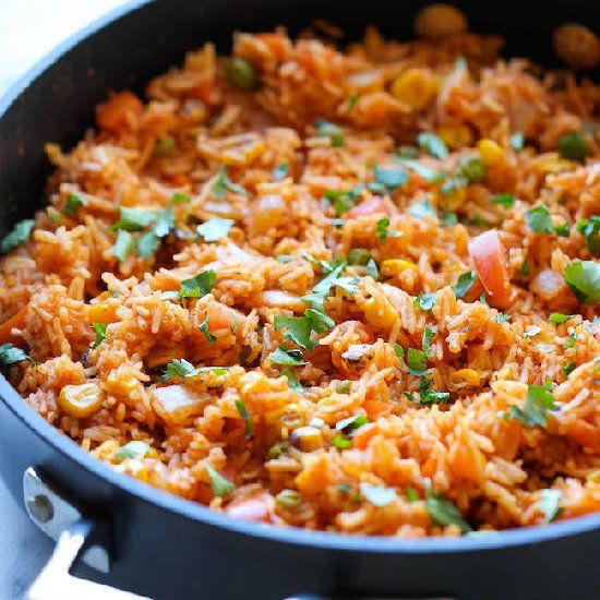 Restaurant-style Mexican rice can easily be made right at home, and it tastes a million times better too!