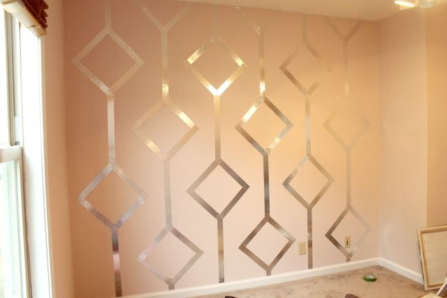 apply foil tape to a wall in a pretty design. $7.50 for the whole thing.