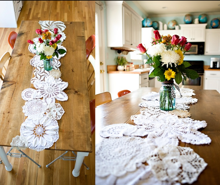 Doily table runner.  For winter you could decoupage paper snowflakes together using the same idea.