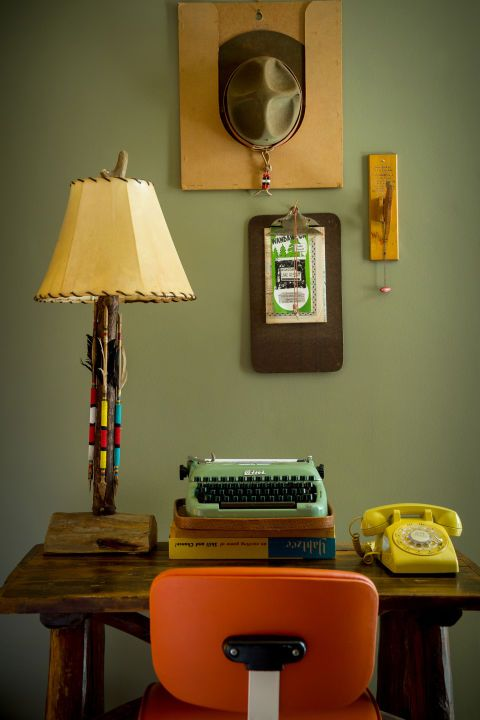 The desk area at the Graduate Madison's Camp Wandawega-themed suite is full of…