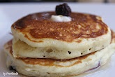 """Best Pancakes  -- Mix together the  flour, baking soda, baking powder and salt.Separately combine beaten eggs, soured milk, melted butter and vanilla. The soured milk helps activate the baking soda-  Creating fluffy pancakes... -- the key to this recipe is to make """"soured milk"""" by combining vinegar with milk. Add wet to dry ingredients and gently mix. Lumps are okay, don't over mix! Let the batter rest for 10 min., until bubbles form. DO NOT STIR. To cook DIP batter onto buttered griddle."""