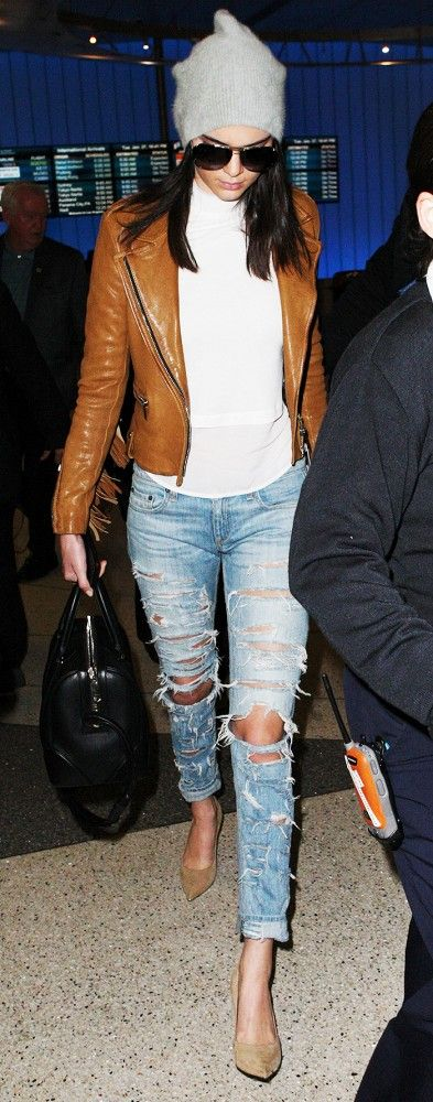 Kendall Jenner keeps it cozy in a white turtleneck and soft grey beanie, adding some edge with a fringed leather jacket, distressed jeans and pointed pumps
